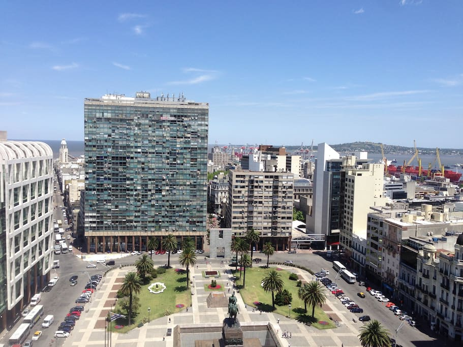 Panoramic view of Plaza Independencia and Montevideo's Bay from the living/dining room and Bedroom 1.
