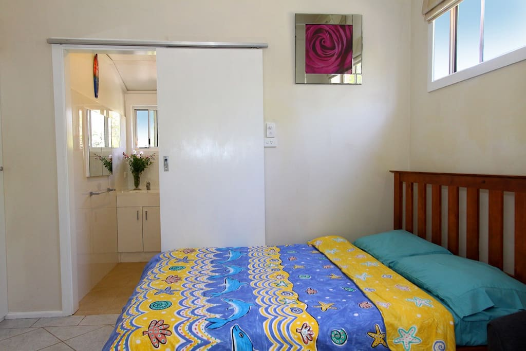 Bedroom with adjacent ensuite.
