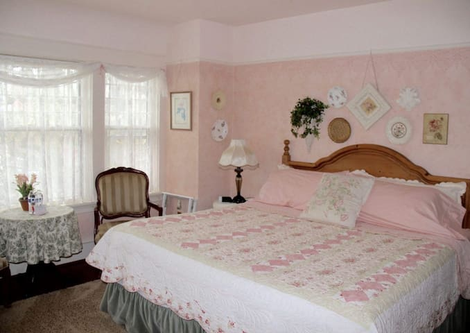 Hearth Room ~ King Bed.  This is a large sunny room with a fireplace and sitting area.