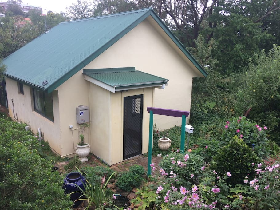 Mini house in garden setting.  Has everything needed for a relaxing stay.  Let us know if we can do anything to make your stay more enjoyable.