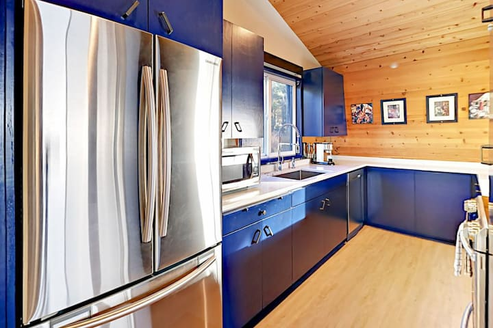The newly remodeled, fully stocked gourmet kitchen has updated quartz countertops and stainless steel appliances.