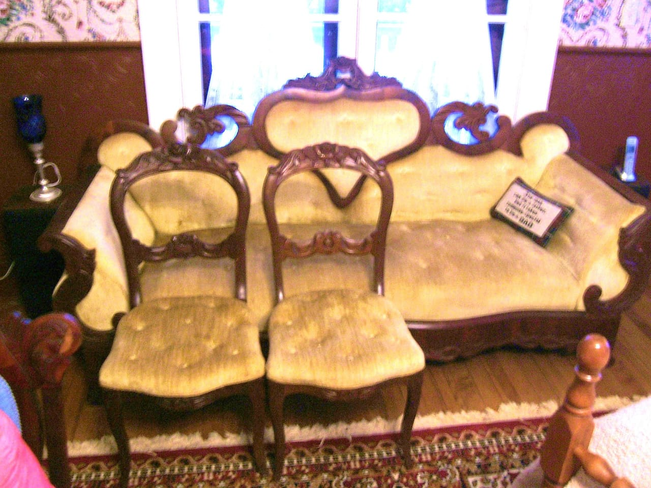 Antique furniture furnishes the Victorian Lady