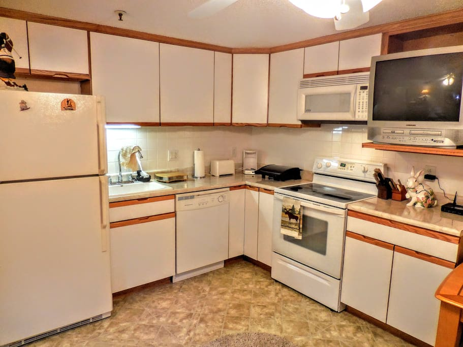 Fully-equipped kitchen with full-sized appliances, pots, pans, utensils, etc.