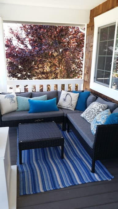 Wicker furniture on covered front porch - perfect for intimate conversation and enjoying a latte while breathing in fresh NW air!!