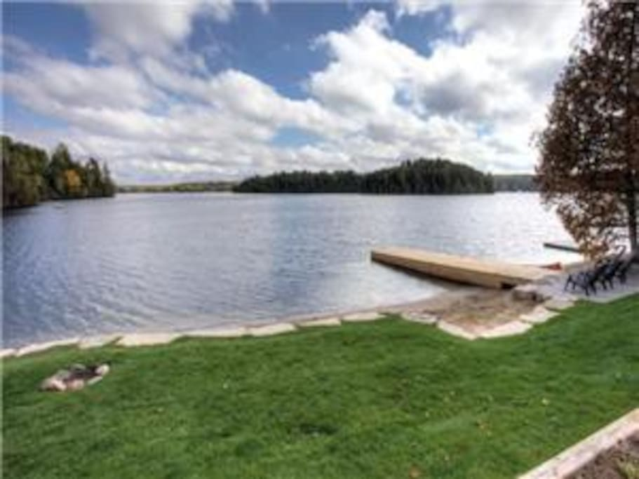 Lots of flat green space for everyone. Fire pit is conveniently placed by the water's edge.