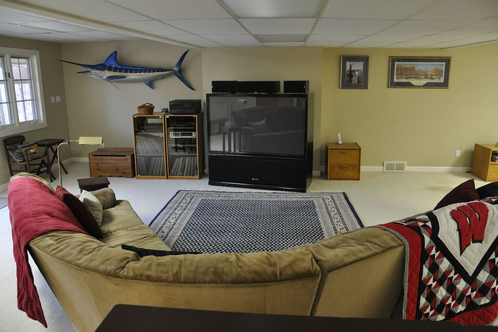 """View of front half of room, 65"""" large screen TV"""