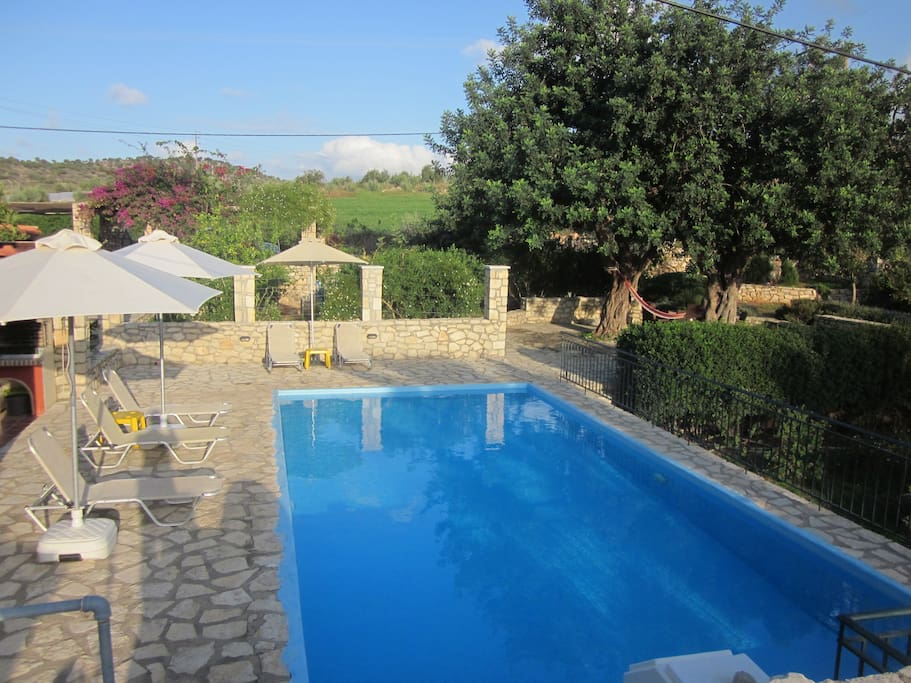 Large stone terrace with private swimming pool and garden