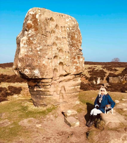 The Cork Stone on Stanton Moor formed in the glacial age is a beautiful selfie spot - this is Sarah and Titch the dog.