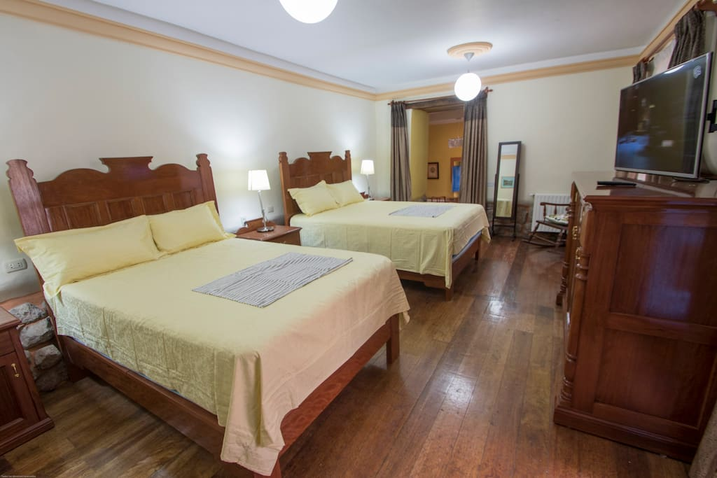 Spacious bedroom with queen and double bed.