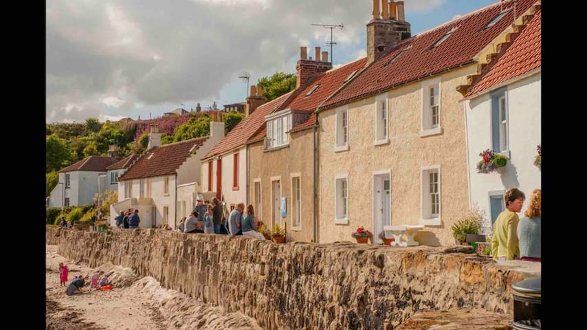 Pittenweem Cottages down by the waterside with small beach at low tide . Mangle cottage is just 5 mins walk away up the hill.