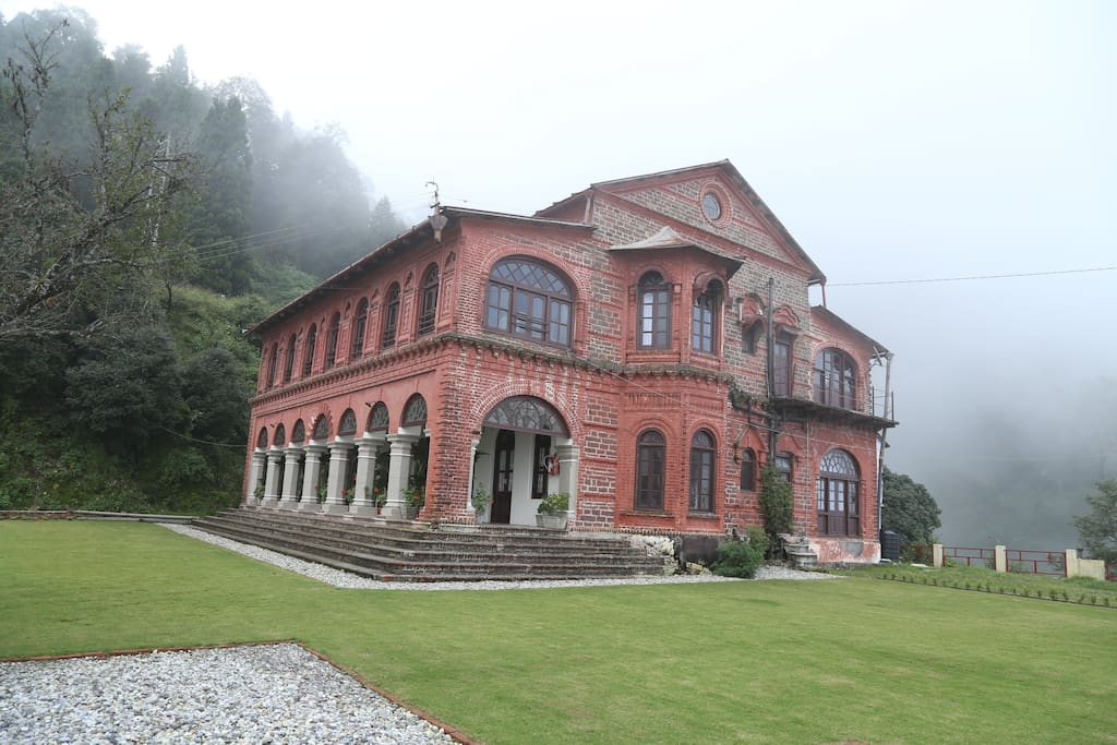 The majestic Raghu Niwas house, affectionately known as 'Lal Kothi' or Red House by the locals, in the August mist