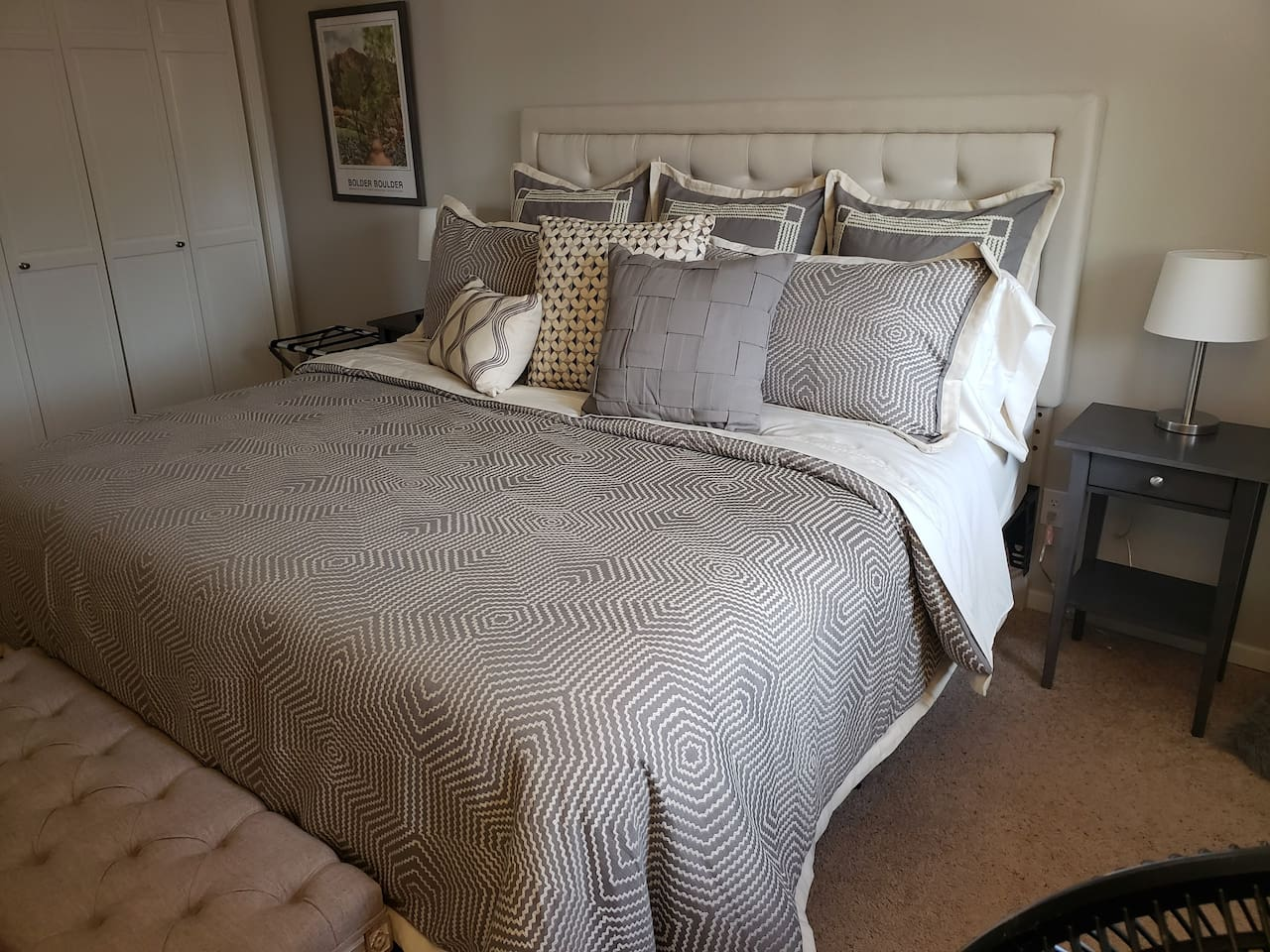 New King sized bed with all new bedding.  Firm mattress with memory foam topper.