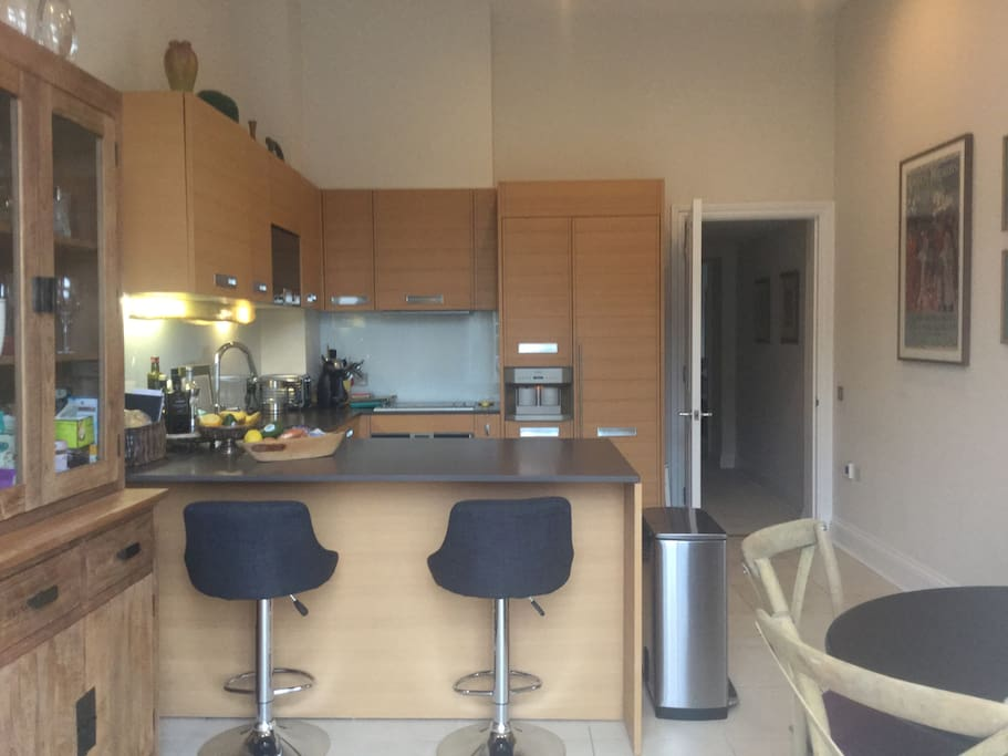 Kitchen with a large counter as well as breakfast table with 4 chairs.