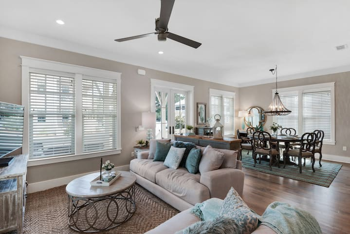 Living room, lots of windows, open to kitchen and dining.  Luxury furnishings, 4.5 baths!  Large open top floor with 2 full beds, pull out couch and attached bath.