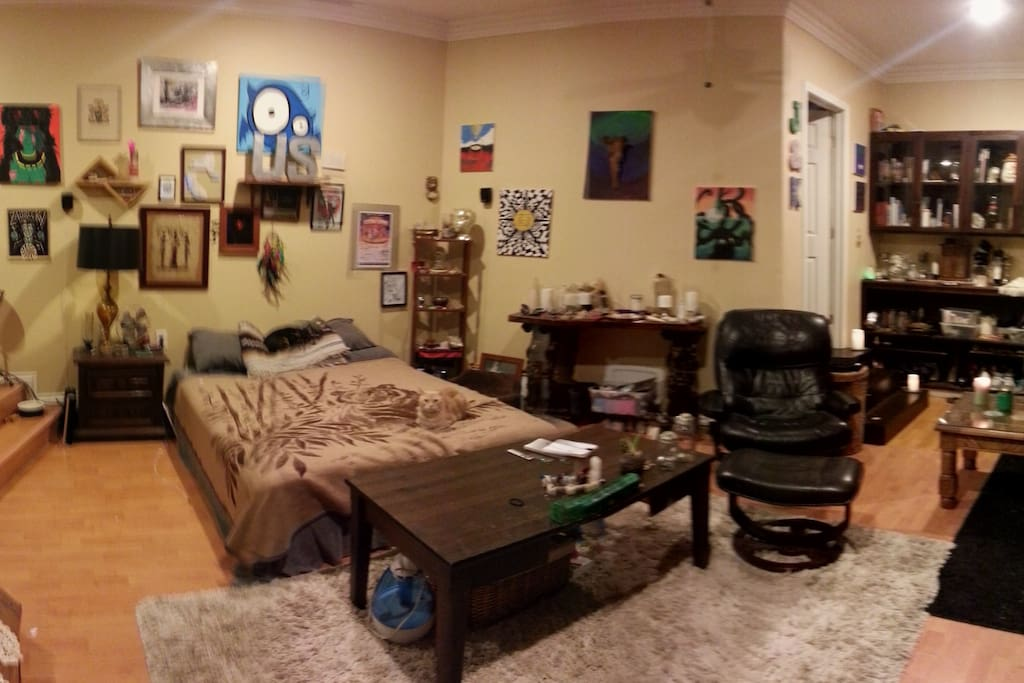 Panorama of the sleeping area, reclining chair, the stairs to the right lead to the bathroom