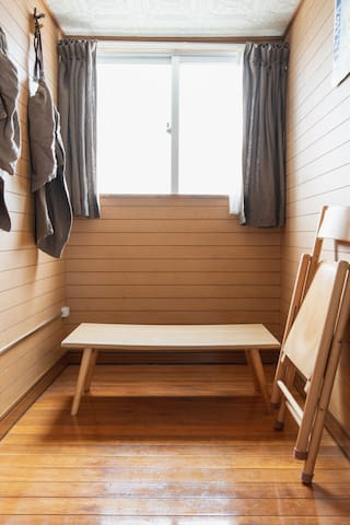 You can see there is a foldable table- Muji style. It can be stored away to make space for your futon. Or you can use it to sip tea and plan your day. You can even use it to set your suitcase on when getting things out or packing things away.