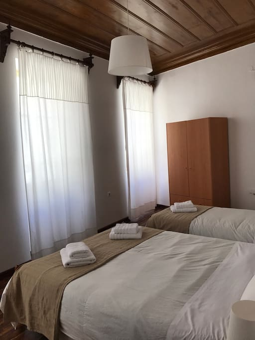 Main bedroom with 1 double plus one single bed and aircondition