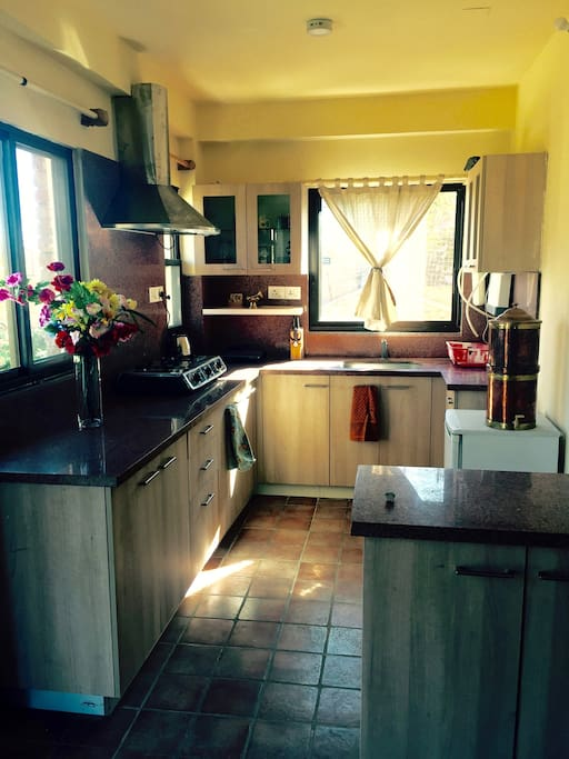 A bright and sunny fully-equipped kitchen.