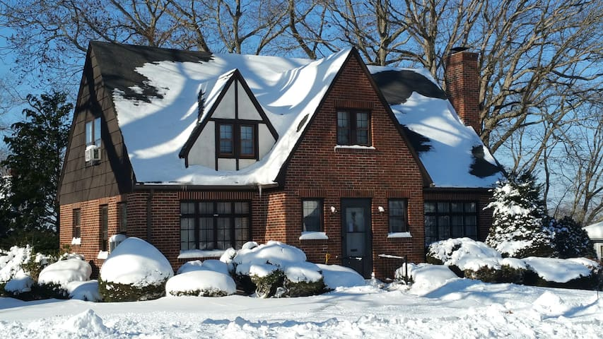 Charming Coastal English Tudor in the Winter Snow.