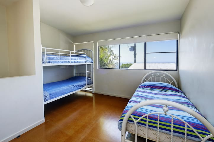 3rd bedroom has a single bed and two single bunk beds...perfect for the kids.