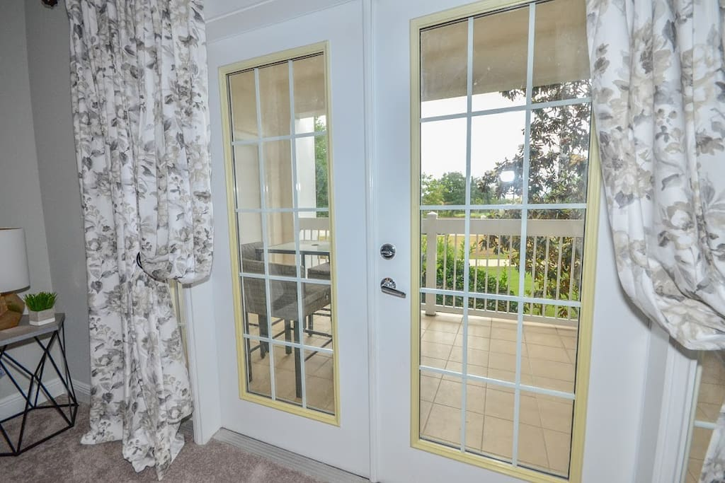 French doors out to private balcony