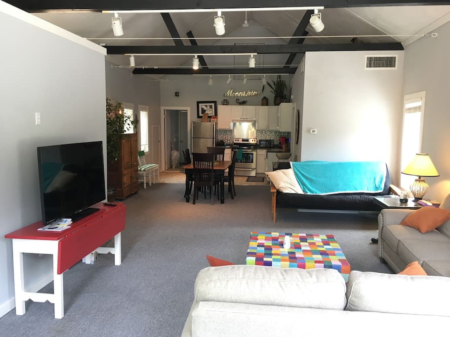 Loft style apartment with single bedroom is loaded with seating space for guests and friends