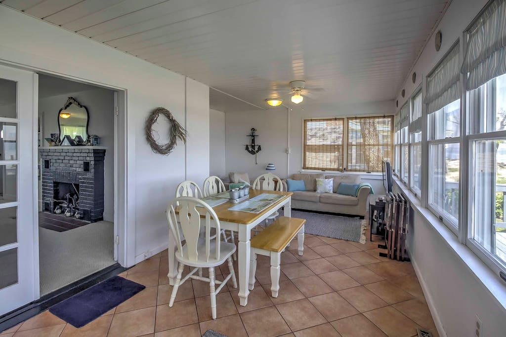 Relax and enjoy memorable dining experiences in the home's expansive sun room!