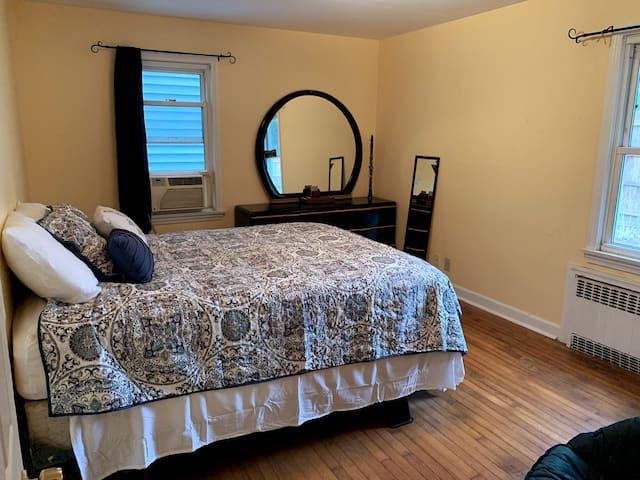 First floor bedroom with queen bed & A/C unit