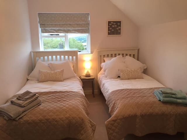 Twin bedroom with views over the Blockley Hills