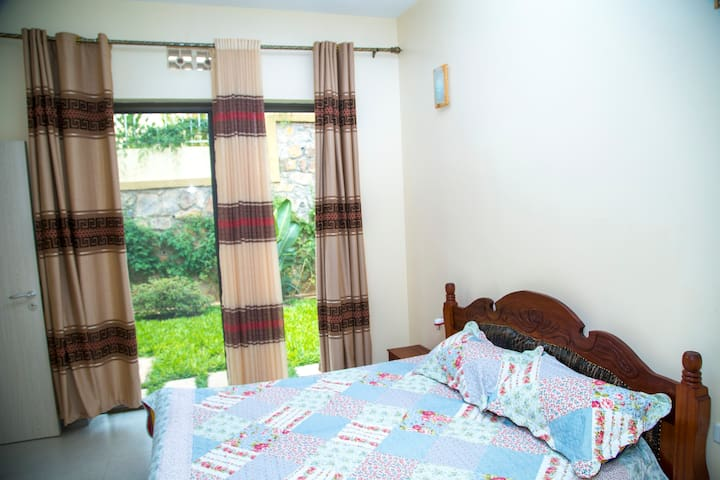 Bedroom 2 with access to a garden