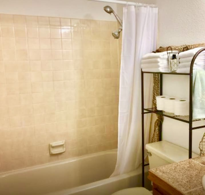 Sparkling clean bathroom with plenty of toiletries, towels, environmental/gentle soaps,shampoo and conditioner.