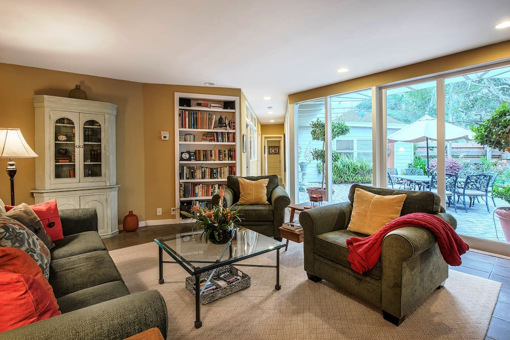 The spacious living room with fireplace is the perfect gathering place.