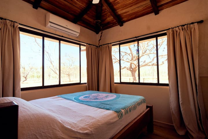 Newly renovated 3 bedrooms with A/C and fans. View on the horses grazing and on nature and beautiful paddock surrounding the house