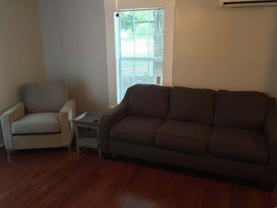 Sofa and chair in den area.