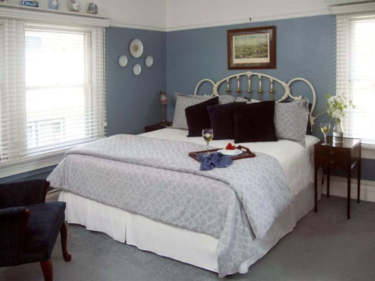 Done in Wedgwood Blue, this bright British inspired room over looks the gardens and has an antique, gentleman's armoir plus an in-room dressing table with sink.