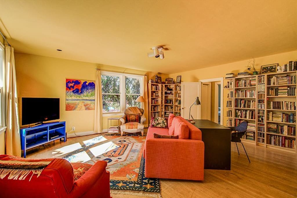 """Cozy living room with new 48"""" TV and pull out full size sleeper couch."""