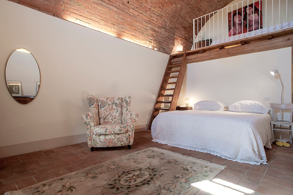 The bedroom is placed in an old winecellar