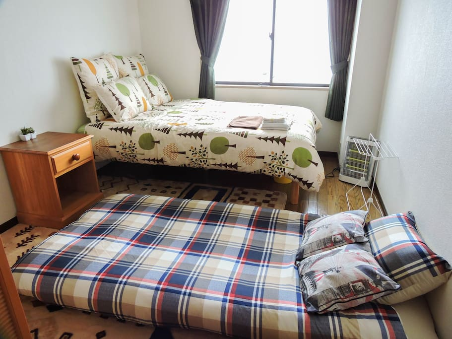 Private bedroom set up for three people. I can host up to 4 people with another futon.