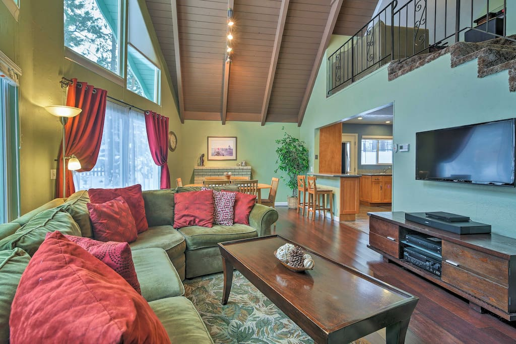 The huge great room hosts a plush L-shaped couch and 42-inch flat-screen.
