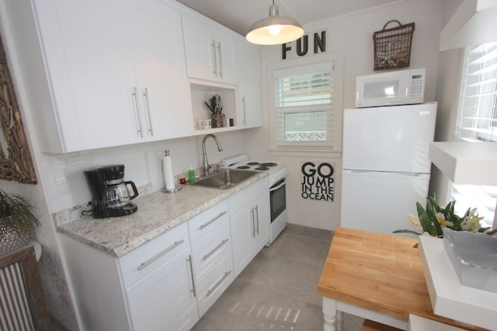 Super Cute Fully Equipped Kitchen with Granite Counter Tops