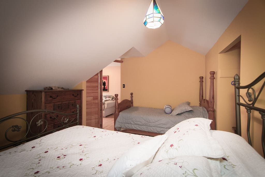 This bedroom features a single bed and a double bed and can sleep a total of 3 people.