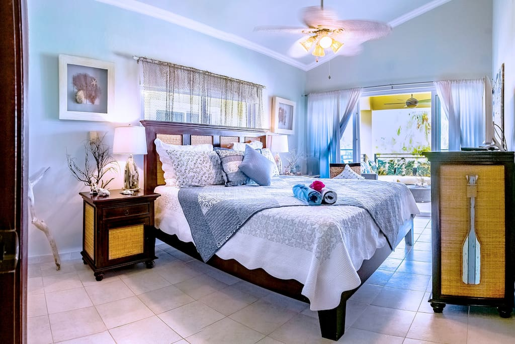Airy and light bedrooms  with a very special Carribean design. AC system and ceiling fans will help you to feel breezy. Feel like home!