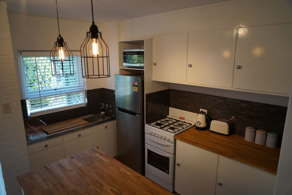 Fully equipped kitchen with all appliances as well as basics such as coffee and tea