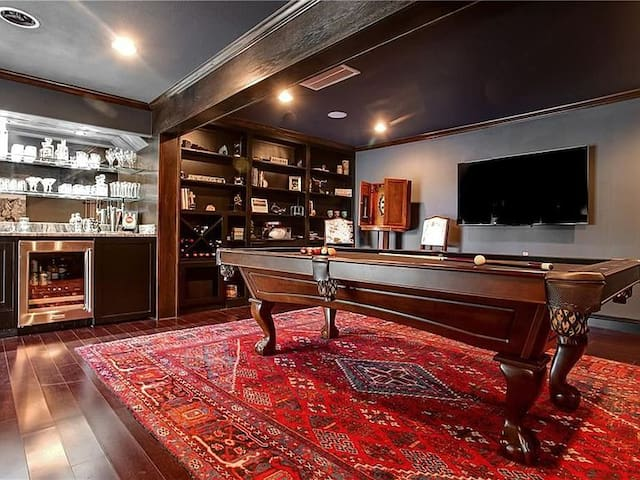 Game Room with Pool table and wet bar.