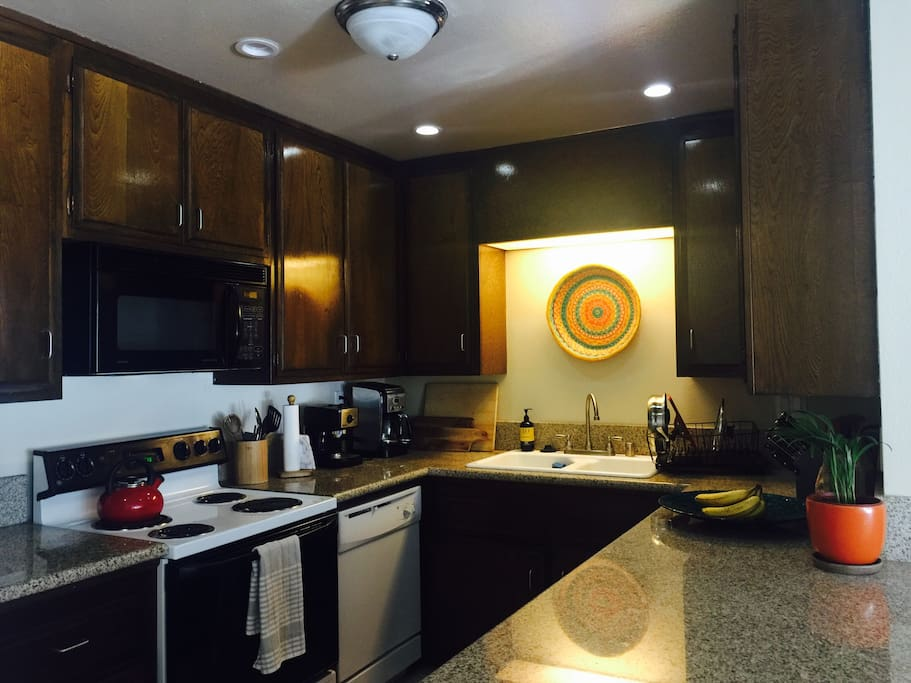 Open kitchen with dishwasher, stove, microwave and all the kitchen supplies and spices you need to cook a fabulous dinner!
