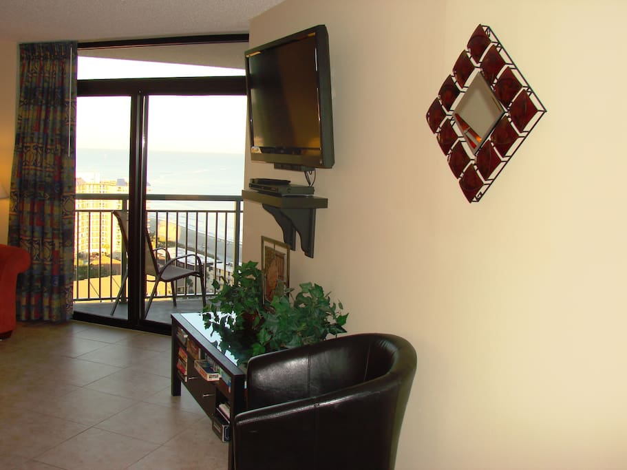 "Private balcony on top 19th floor to sit and watch the ocean. 42"" flat-screen Visio TV with Blu-Ray player. MP3 speakers and subwoofer for quality music sound."
