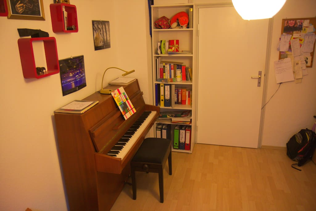 Piano within the bedroom