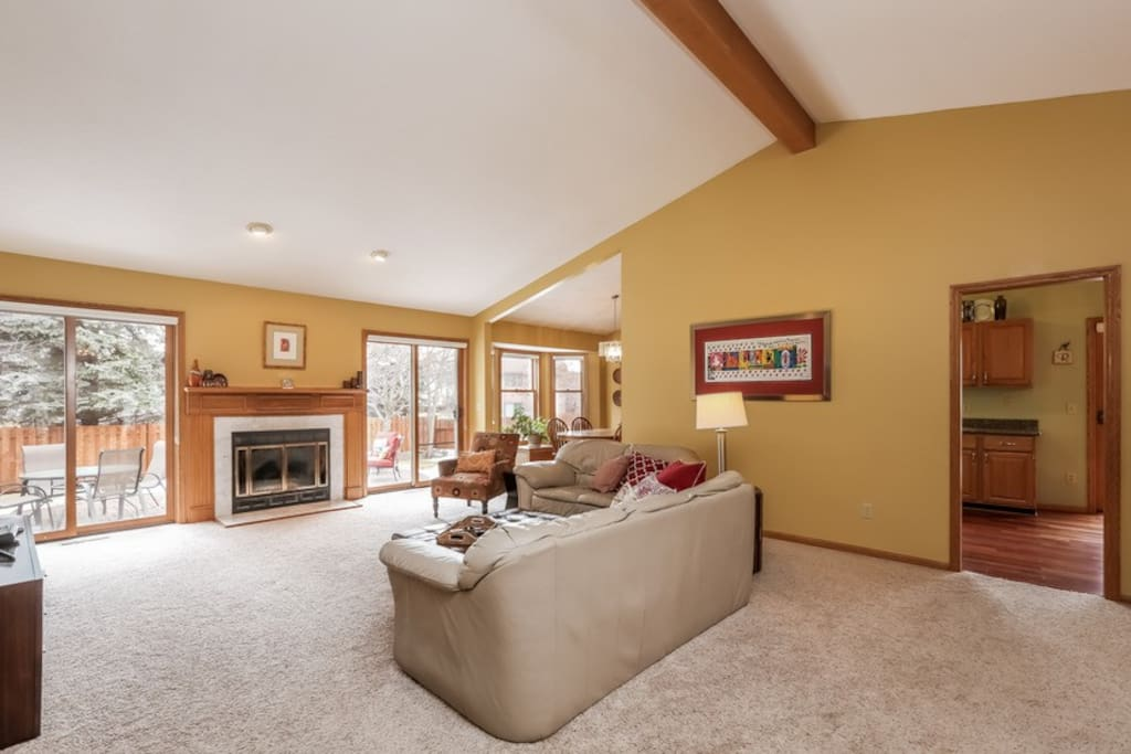Main level living space. With wood burning fireplace.
