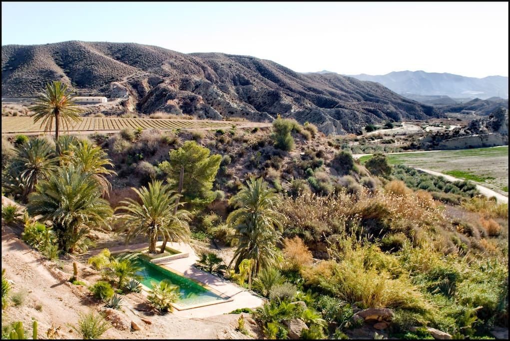 Vista de la piscina desde el balcón de la habitación principal