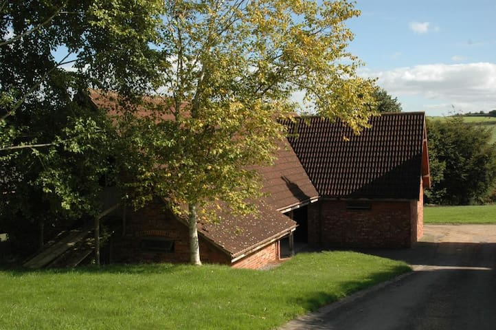 Brick built stable with Lodden boxes - can accommodate 4 horses